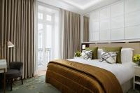 resized_corinthiahotel_garden_suite_bedroom.jpg