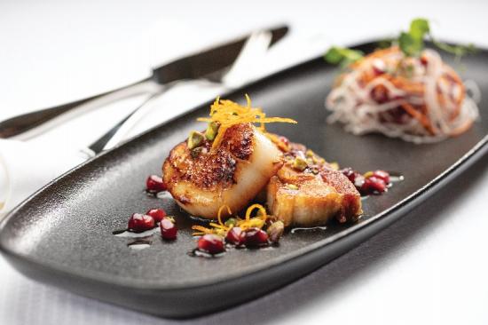 seared-diver-scallop-cured-pork-belly-confit-orange-pomegranate-sauce.jpg
